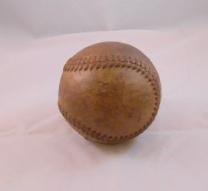 No other notable markings can be seen on the baseball. This is a common WWII U.S. military baseball.