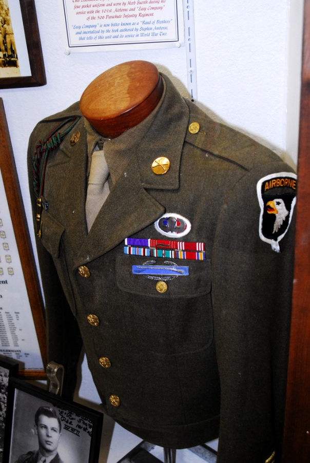 "Private Herb Suerth (of ""E"" Company, 506 PIR, 101st A/B) ""Ike"" jacket on display at the Indiana Military Museum."