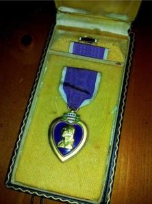 This is a World War II Purple Heart Medal set complete with the ribbon and lapel device in the correct presentation case.