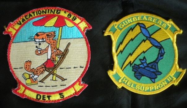 The patch on the right is the helicopter squadron's official insignia while the patch on the left was custom-made in the Philippines for the specific deployment (in 1989) and detachment (Det. 5) from the unit.