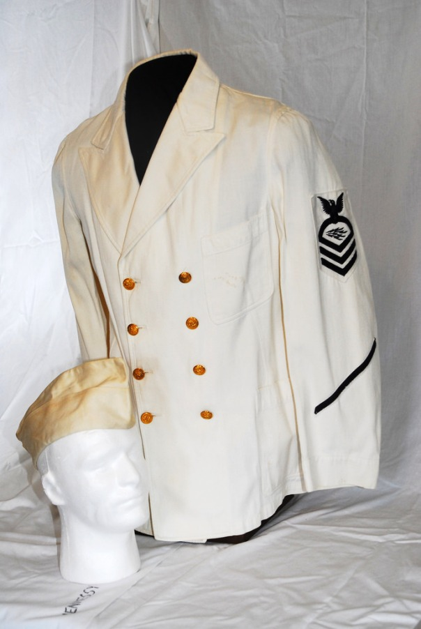 Pictured here with an early WWII chief radioman's eight-button, dress white uniform jacket, the (yellowing and aged) white garrison cover is a bit more distinguishable from a khaki variant.