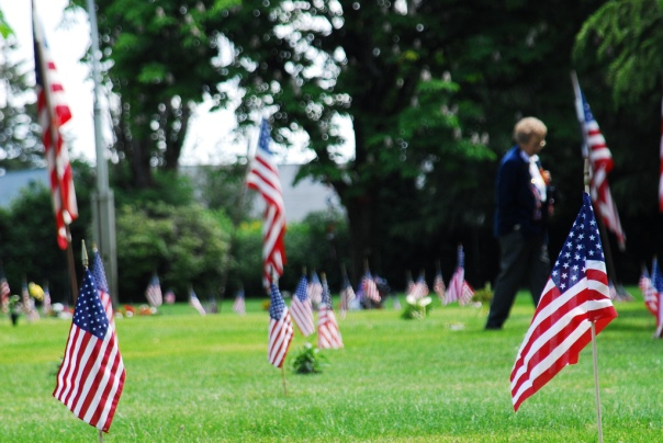 A woman walks the cemetery grounds on Memorial Day.