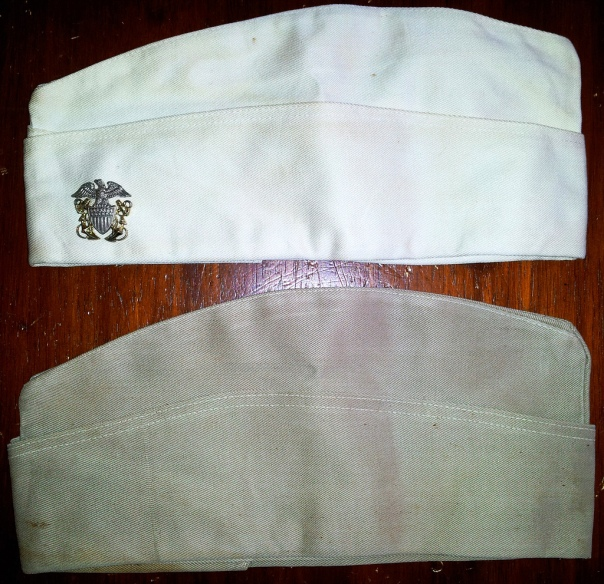 A Garrison Comparison: at the top is the white garrison (compared with a WWII khaki) demonstrating that, though it is yellowed, it is the rare white cap.