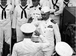 This shot shows Captain George C. Dyer departing the Astoria wearing his dress white uniform and the white garrison cover (source: Brent Jones Collection).