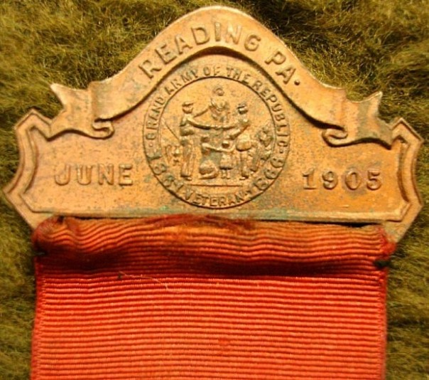 The national encampment medal's brooch reflects the date and location of the 1905 Reading, PA gathering with the GAR seal prominently displayed in the center (source: eBay image).