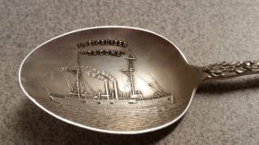 "The inside of the bowl has a very detailed depiction of the cruiser. The reverse of the spoon is engraved with ""1907, Helen."""