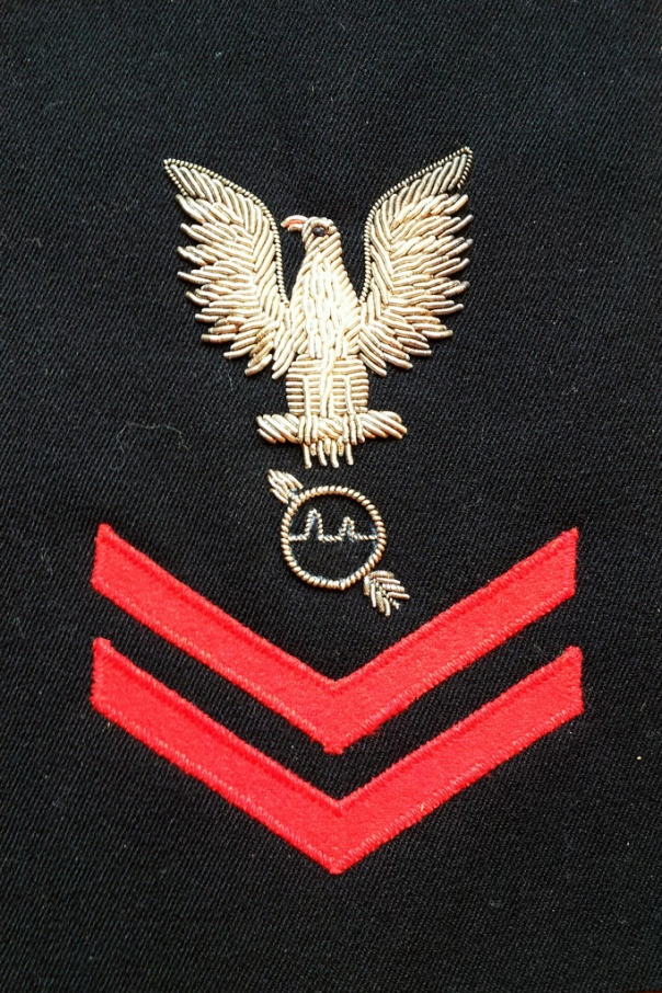 A rare bird. This Radarman/Operations Specialist 2/c badge is not collectors can easily find. Bullion rates were for E-6 and above and this one is clearly not a cut-down E-6 rating badge.