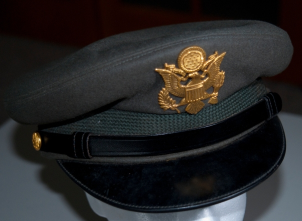 As I scour my collection, I begin to realize that the overwhelming majority of items are Navy-centric. This 1950s U.S, Army cap is part of the display that I am assembling of my paternal grandfather's older brother's service.