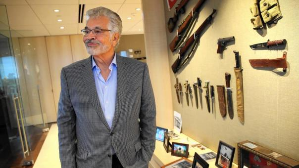 Dick Portillo, shown with military memorabilia in his Oak Brook office Sept, 8, 2016, is on a quest to determine whether a gold tooth discovered on a Pacific island is that of Japanese Cmdr. Isoroku Yamamoto, who planned the Pearl Harbor attack and who was shot down in 1943. (Terrence Antonio James / Chicago Tribune)