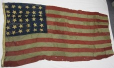 From the Battle of Manila Bay, this flag flew over the USS Olympia (Source: Naval Historical & Heritage Command).