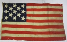 This small flag was used on one of the small boats from Dewey's flagship, the USS Olympia (Source: Naval Historical & Heritage Command).
