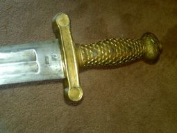Showing the hilt and maker's marks on the Ames Model 1832 Artillery Foot Sword.