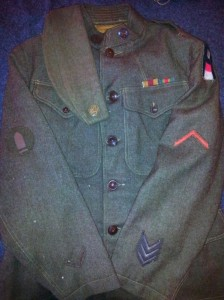 An overview of the uniform (and overseas cap) that I have recreated to represent my uncle's WWI service. Note the artillery shell insignia on the right sleeve is that of a First Class Gunner.
