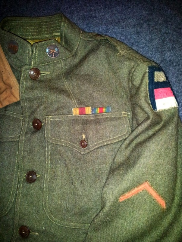 A close up of the SSI of the 1st Army (with the red and white bars of the artillery), my uncle's collar disks, the honorable discharge chevron and his actual ribbons.
