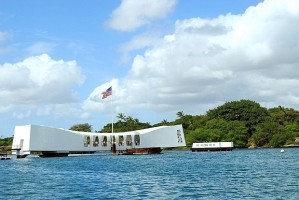 The memorial structure straddles the stricken ship's hull as she rests in the mud and silt of Pearl Harbor.