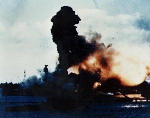 A rare color image showing the USS Arizona's forward magazine detonating after it was struck by a high altitude aerial bomb (Source: U.S. Navy Naval History and Heritage Command).