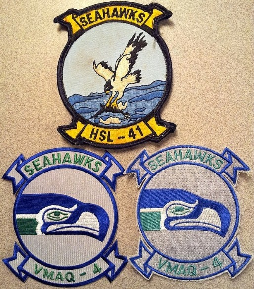 "These patches represent two squadrons – one a USMC electronic warfare squadron and the other, an anti-submarine warfare helicopter squadron. Both bear the same nickname of ""Seahawks."" The bottom two patches' design was incorporated into the Marine Tactical Electronic Warfare Squadron (#4) when it was based at NAS Whibey Island in Washington State. The Seahawks (squadron) adopted the imagery from the Seahawks (the local NFL team). Since relocating to Marine Corps Air Station Cherry Point, VMAQ-4 departed from the NFL-based design,"
