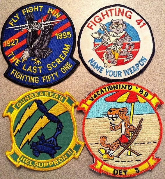 Counterclockwise from top left: VF-51 Screaming Eagles as the unit was being deactivated; VF-41 sporting the Tomcat character (for the F-14 Tomcat aircraft); HC-11, Detachment 5′s WestPac cruise patch; HC-11 squadron patch.