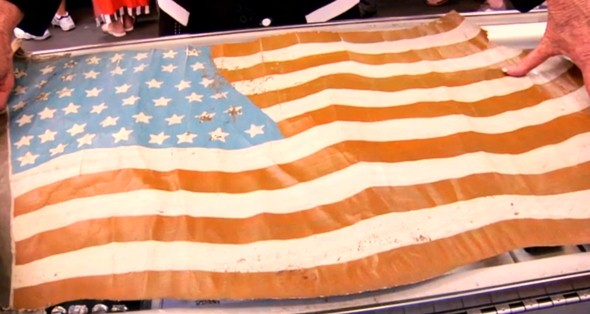 This flag looks to have been cut from a WWI American aircraft. The jury is still out as to whose aircraft it was removed from (source: Pawn Stars screen grab).