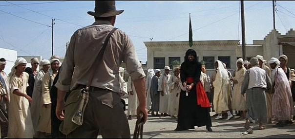 Indiana Jones faces off with a sword-wielding opponent on the streets of Cairo in Raiders of the Lost Ark (source: Paramount Home Entertainment (Firm). (2008). Raiders of the lost ark. Hollywood, Calif: Paramount Home Entertainment).