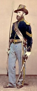 This uniform, though an immediate post-Civil War-issue, is clearly that of a sergeant in the U.S. Cavalry as noted by the gold chevrons (hand-tinted in the photo).