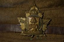 The close up of the CFC badge - the insignia incorporates crossed pikes superimposed over a maple leaf with a long crosscut saw with a beaver (eBay image).